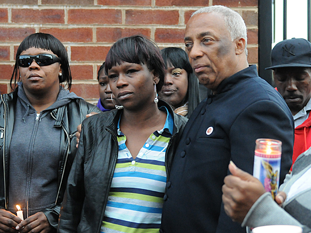 City Councilman Charles Barron stands next to Yakim McDaniels mother, Doris Chase, at a vigil for her son, May 7, 2012.