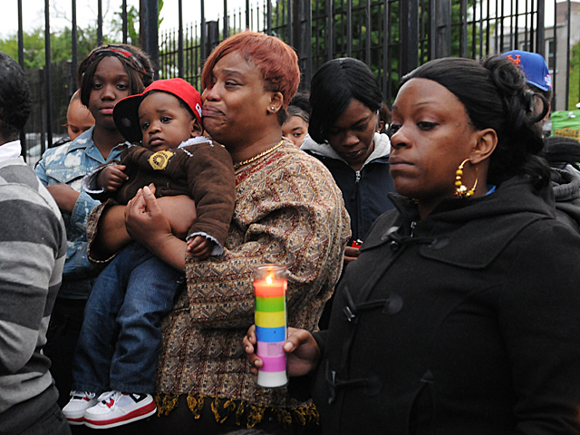 Family and friends mourn the death of Yakim McDaniels on May 7, 2012.
