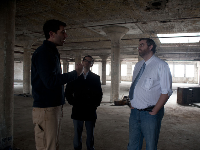 Ian Siegel (far left), of Salmar Properties, gives Sunset Park District Manager Jeremy Laufer (far right) his first tour of the building since construction began this year. May 8, 2012.