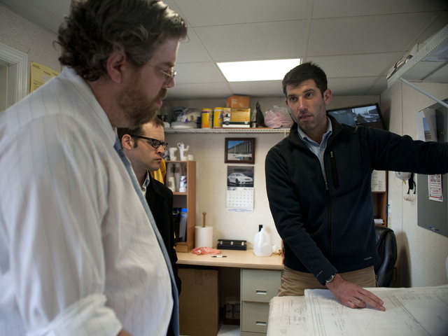 Site director Ian Siegel goes over building plans with Jeremy Laufer and David Meade-- of the Southwest Brooklyn Industrial Development Corporation, a local organization that will help to connect local workers with jobs created by the project. May 8, 2012.