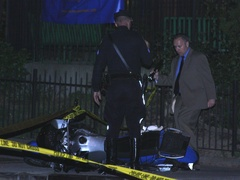 Police inspect motorcycle