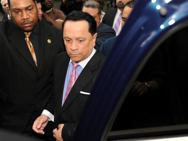Ex Senator Pedro Espada is escorted to a waiting SUV outside of Brooklyn Federal Court on Monday May 14th, 2012.
