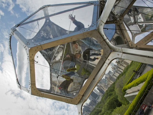 Tomas Saraceno looks out from a module of his Cloud City.