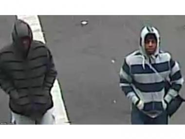 Cops are searching for the two men pictured above, who allegedly robbed employees of East Harlem parking garage at gunpoint on Tues., May 8, 2012.
