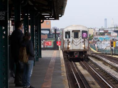 A 7 train arrives at 82nd St. station at Jackson Heights.