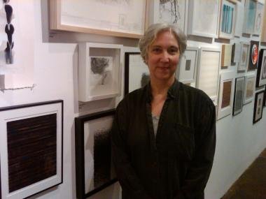 "Florence Neal, director and co-founder of the Kentler International Drawing Space, poses for a photo in front of the drawings that will be exhibited at the art center's ""100 Works on Paper."""