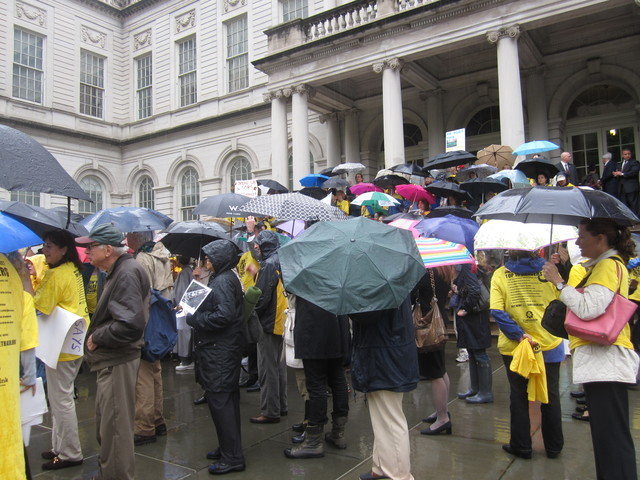 The rain didn't stop Upper East Sid end East Harlem residents to come down to City Hall Tuesday to protest the East 91st Street marine transfer station.