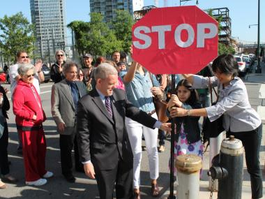 Residents and councilman Jimmy Van Bramer are erecting a cardboard stop sign at the intersection of 5th Street and 47th Avenue in Hunters Point