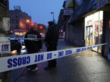 Police respond to a shooting inside Rugged Sole shoe store on the evening of May 21, 2012