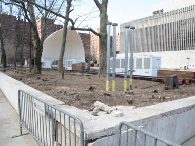 Damrosch Park in March 2011, after bushes and a sign indicating that the park is a public park were removed.