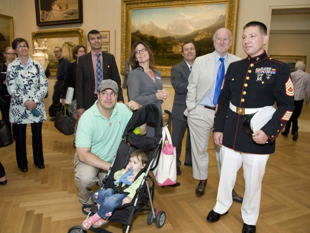 (R-L) Gunnery Sergeant Mark Butler and Creel Brown, Captain, U.S. Army and daughter Riley at the Blue Star Museums launch at The MET on May 22, 2012.