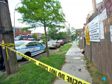 A Flushing woman was clinging to life after her husband allegedly attacked her on May 23, 2012.