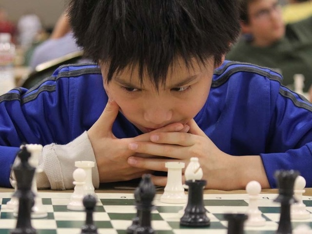 <p>Spencer Ha considers his next move.</p>