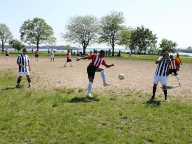 Members of the New York Honduras Soccer League play at Ferry Point Park in Throgs Neck. Most of the players live around Crotona Park, which is five miles west of Ferry Point.