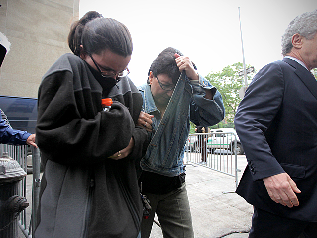 Pedro Hernandez's wife, Rosemary, and his daughter, Becky, outside Manhattan Criminal Court Friday.