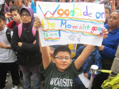 Dozens of parents, children and elected officials rallied with Woodside on the Move on Wednesday and Thursday in front of schools hoping to get at least some of the funding restored.