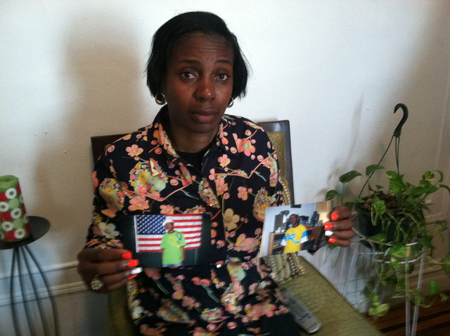 Genevieve Roberts-Killiebrew holds of two photos of her son, Isaiah, 19, who was killed from a gunshot wound in Bedford-Stuyvesant on May 25, 2012.