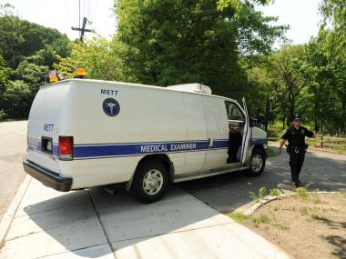 Employees from the Medical Examiner's Office arrive at Oakland Lake Park to remove the body of the deceased on Monday May 28th, 2012.