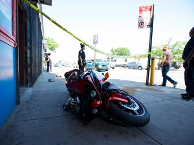 The motorcycle was rear-ended by minivan in Jackson Heights on May 31, 2012.