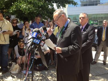 U.S. Sen. Charles Schumer speaks at a press conference in Chinatown about a federal crackdown on low-cost bus lines.