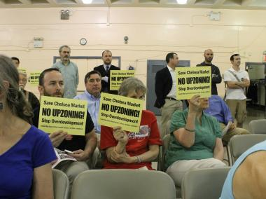 Opponents of a proposed expansion to Chelsea Market silently protest at a meeting on May 31, 2012.