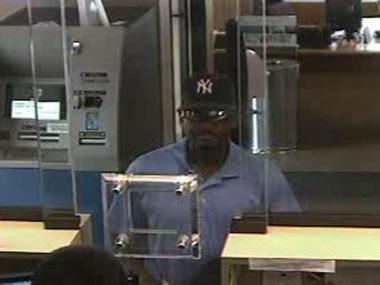 Police are looking for this man in connection with a robbery at a Chase Bank at 54-12 48th Avenue in Queens on May 30.