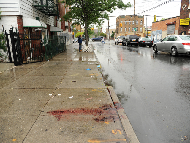 Blood from the deceased remains in front of 2814 West 15th Street in Brooklyn on Monday June 4th, 2012.