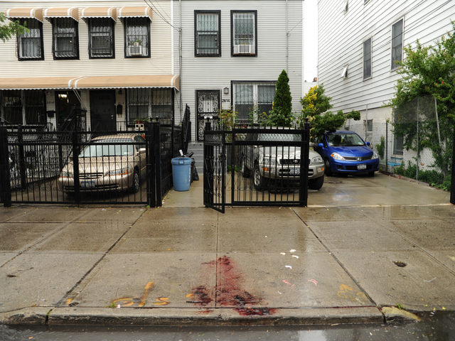 A pool of blood remains in front of 2814 West 15th Street in Brooklyn where a man was stabbed to death on Monday June 4th, 2012.