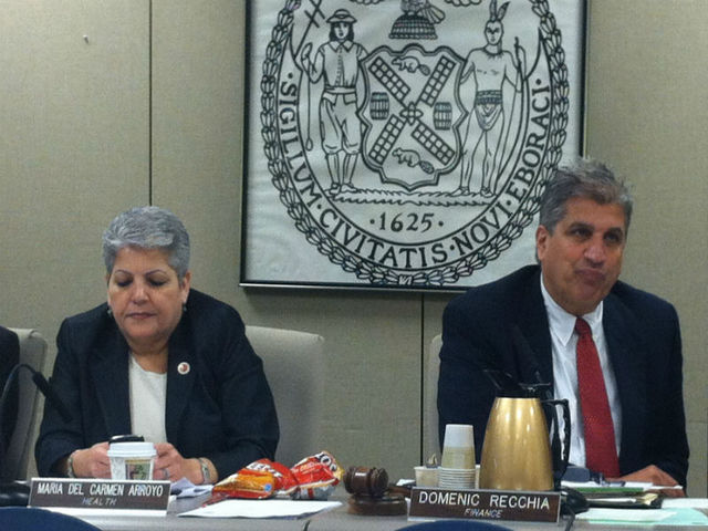 <p>Councilpeople Maria del Carmen Arroyo and Domenic Recchia nosh on some chips.</p>