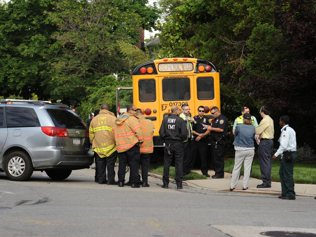 <p>Officials at the scene of a school bus crash in Queens on Tuesday June 5, 2012.</p>