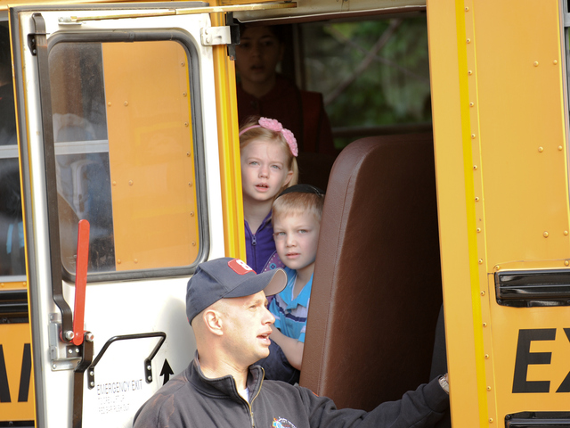 <p>Children on the bus wait to be checked out by paramedics on Tuesday June 5, 2012.</p>