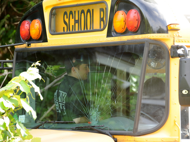 <p>The cracked windshield of the school bus in Queens on Tuesday June 5, 2012.</p>