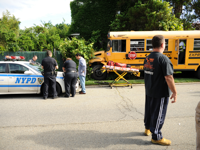 <p>The school bus ended up in the yard of 75-32 174th Street in Queens on Tuesday June 5, 2012.</p>