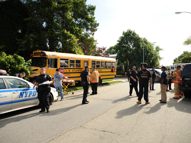 <p>The scene of a school bus and minivan crash in Queens on Tuesday June 5, 2012.</p>
