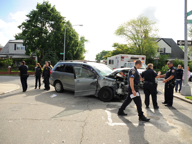 <p>This minivan crashed into a school bus in Queens on Tuesday June 5, 2012.</p>
