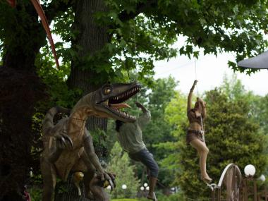Alla Shchegol decorated her lawn with dozens of large, life-like statues of dinosaurs, people and wild animals.