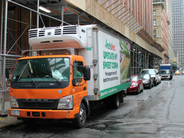A FreshDirect truck idling on Thomas Street. FreshDirect is mulling a plan to use bicycles to deliver food.