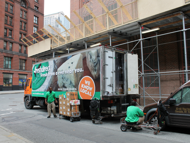 Outside the FreshDirect truck on Thomas Street, workers often hang out on handcarts in between deliveries, locals said. FreshDirect is mulling a plan to use bicycles to deliver food.