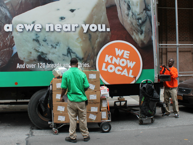 FreshDirect workers on Thomas Street, where their truck is frequently parked. FreshDirect is mulling a plan to use bicycles to deliver food.