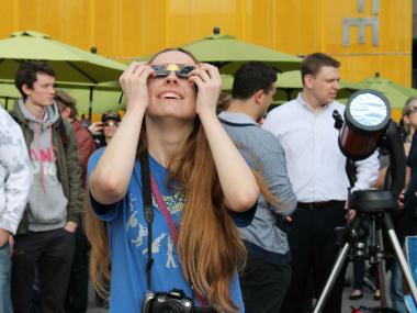 Hunter College student Anne-Lilja Rentof waits expectantly for Venus to cross the sun.