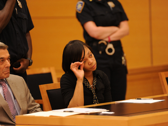 Carlotta Brett Pierce plucks her eyebrows at her sentencing on Wednesday June 6th, 2012.