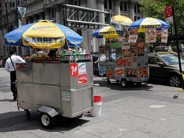 The battle broke out between this hot dog cart and nearby vendors.
