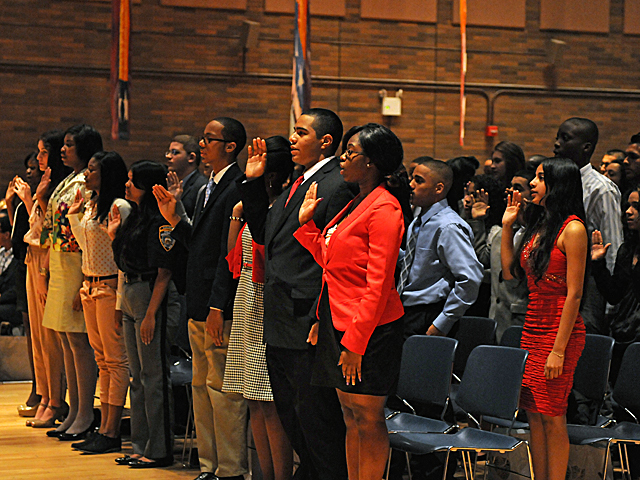 Students from city schools take an oath before spending the day with precinct commanders.