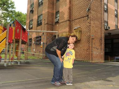 Sally Maldonado, the director of the nursery, is seen here with 4-year-old Alexander Krikler at the playground.