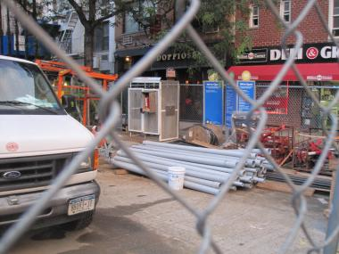 DoppioSenso is barely visible through all the construction equipment and fencing lining Second Avenue.