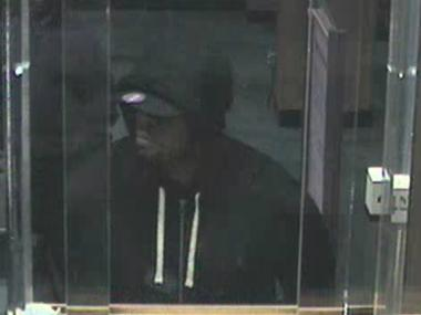 Police are searching for the man pictured in this surveillance video image, who allegedly robbed two banks in Flatbush on May 21.