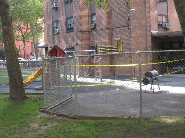 The playground where the unit fell remained cordoned off by yellow caution tape Thursday.