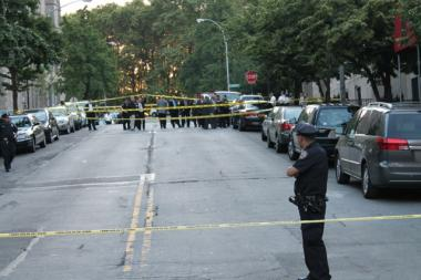 West 122nd Street is closed off following a triple homicide on June 7, 2012.
