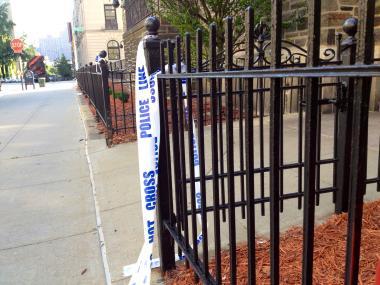 Crime scene tape hangs on a fence on June 8, 2012.