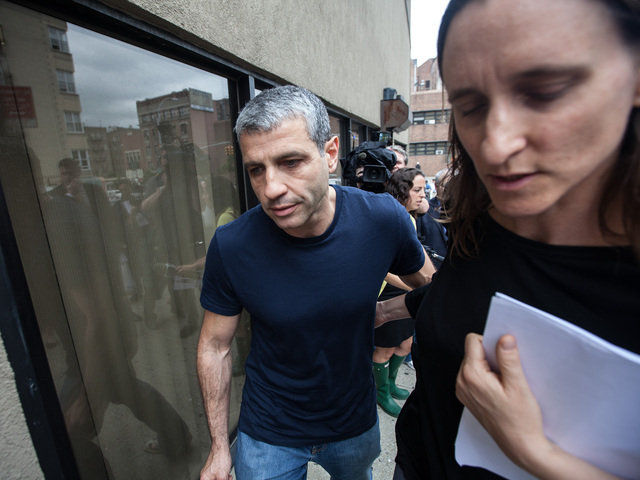Dimitry Sheinman, 47, with his wife Jane left the 34th Precinct after handing in information relating to the murder of Sarah Fox  on June 12th, 2012.